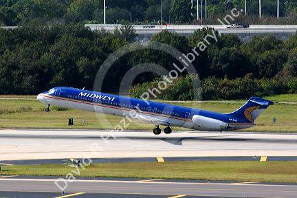 Midwest MD-80 airliner taking off from the Tampa International Airport, Tampa, Florida.