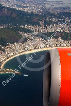 Aerial view of Copacabana Beach in Rio de Janeiro and jet engine from an airliner in Brazil.