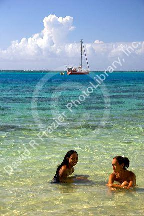 Tahitian women swimming topless in the lagoon on the island of Moorea. MR