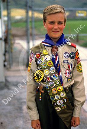 Boy scout in uniform with sash of badges. | David R. Frazier ...