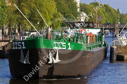 Barge on the Amstel River in Amsterdam, Netherlands.