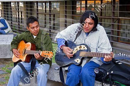 Mexican men playing acoustic guitars in Mexico City, Mexico.