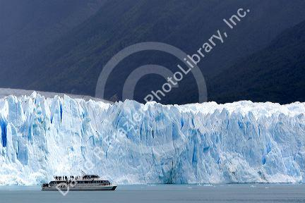 Tour boat in front of the Perito Moreno Glacier located in the Los Glaciares National Park in the south west of Santa Cruz province, Patagonia, Argentina.