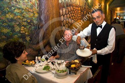 Waiter serving food in a restaurant in Buenos Aires, Argentina.