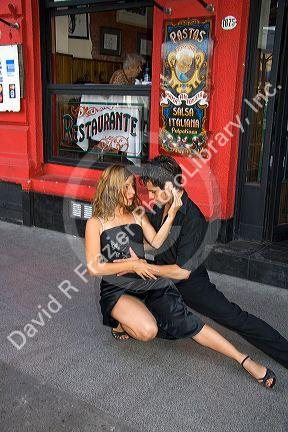 Tango dancers in front of a restaurant in Buenos Aires, Argentina.