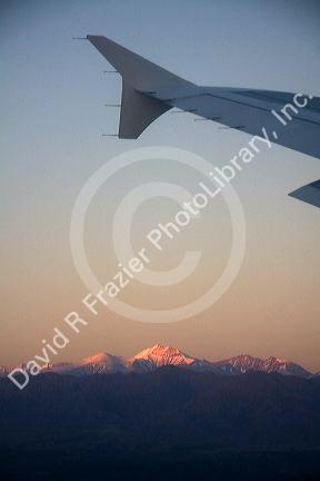 Aerial view of the Andes in Argentina at sunrise through the window of an airplane.