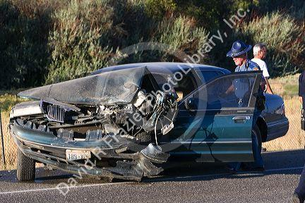 Police officer on the scene of a car accident at Kennewick ...