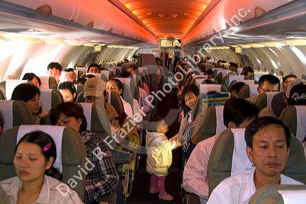 Passengers in their seats on an airliner in Vietnam.