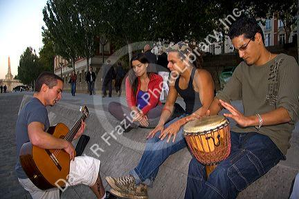 Young parisiens play music along the River Seine in Paris, France.