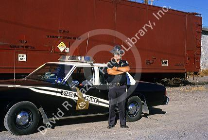 Idaho State Police Officer Guards A Train Carrying Nuclear Waste Before Returning It To Colorado