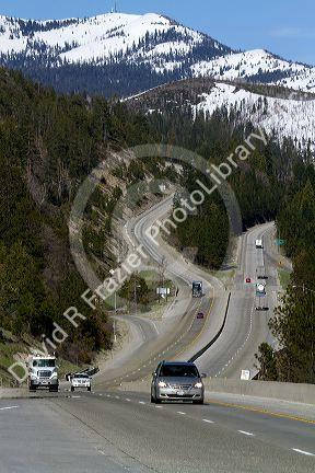 Vehicles travel on Interstate 80 near Donner Pass in the Sierra Nevada mountains, California, USA.
