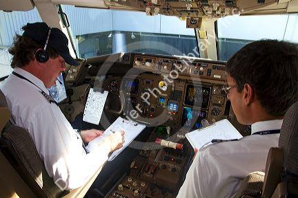 Pilot and first officer reviewing a pre-flight checklist in