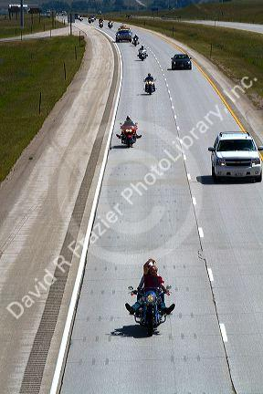 Motorcycles and automobiles travel on I-90 during Sturgis Motorcycle rally week west of Spearfish, South Dakota, USA.