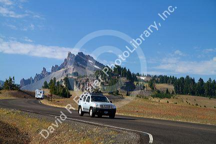 Vehicles travel through Crater Lake National Park located in southern Oregon, USA.