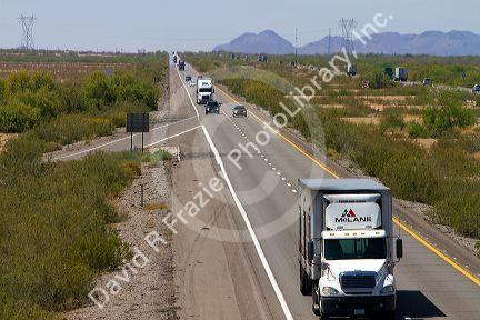 Vehicles travel on Interstate 10 west of Phoenix, Arizona, USA.