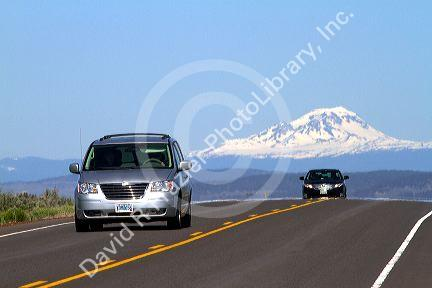 Automobiles travel on U.S. Route 20 east of Bend, Oregon, USA.