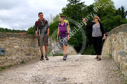 Modern day pilgrims walk along the Camino De Santiago, the ...