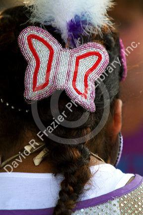 Blackfoot indian girl wearing a beaded butterfly hair
