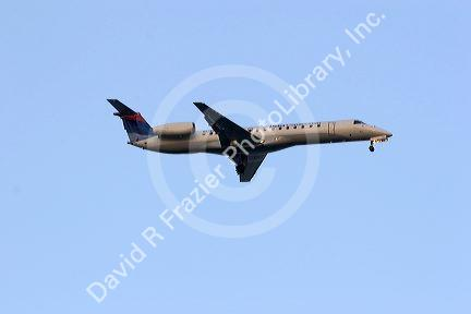 Commuter jet,  regional jet airplane in flight.