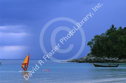 A person wind surfing at Phuket Island, Thailand.