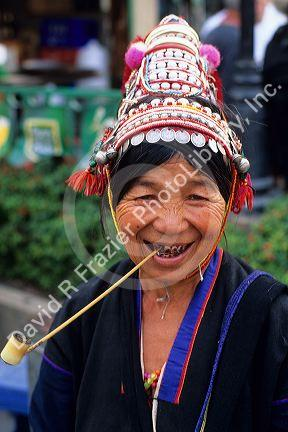 Hill Tribe woman smoking a pipe in Thailand.