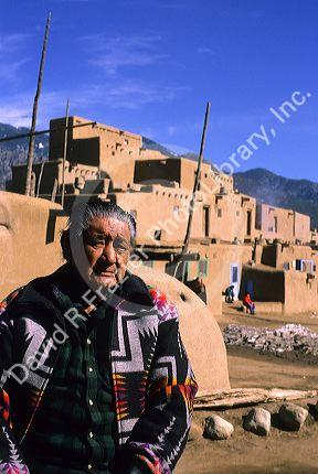Indian pueblo man and adobe buildings in Taos, New Mexico.