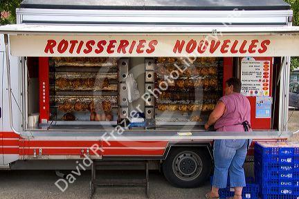 Rotisserie Chicken Being Sold At An Open Air Market In Neuf Brisach