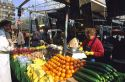 French woman shopping for fruits and vegetables at a stand in Paris, France.