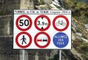 Signs at an entrance to a tunnel in France.