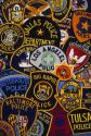 A collage of United States police officer shoulder patches.