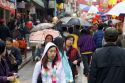 People walking with umbrellas in Chinatown, San Francisco, California.