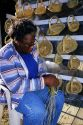 African american woman making sweet grass baskets in Charleston, South Carolina.