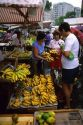 People shop at an outdoor market in Manaus, Brazil.