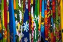 Colorful pareu wraps being sold at a market in Papeete on the island of Tahiti.