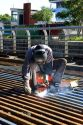 Construction worker welding on bridge deck in Buenos Aires, Argentina.