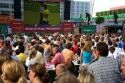 A crowd outdoors at the Munich airport watch a 2006 World Cup match on big screen televisions, Germany.