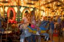 Children and adults ride a carousel at the Iowa state fair in Des Moines.