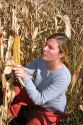 A female farmer looks at feed corn in Canyon County, Idaho. MR