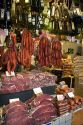 Cured meats, sausages, and olive oil being sold at the Mercado Municipal in Sao Paulo, Brazil.