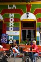 People dine outdoors at a restaurant in the La Boca area of Buenos Aires, Argentina.