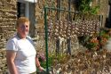 French woman selling garlic at Saint-Broladre in the  Brittany  province of France.