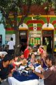 People dine outdoors in the La Boca barrio of Buenos Aires, Argentina.