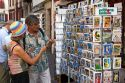 Tourists shop for postcards in the town of Saint-Jean-de-Luz, Pyrenees-Atlantiques, French Basque Country, Southwest France.