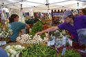 Customers purchase fresh vegetables from a farmers market in Boise, Idaho, USA.