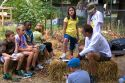 Students and teacher in a summer gardening class identify weeds from a residential garden in Boise, Idaho, USA.
