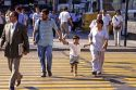 Parents hold their childs hand while crossing the street in Santiago, Chile.