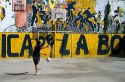 Argentine boy playing soccer in the La Boca barrio of Buenos Aires, Argentina.