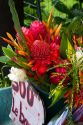 A bouquet of tropical flowers being sold at a self serve stand on Tahiti, French Polynesia.